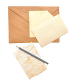 Old photos, envelope and pencil Royalty Free Stock Image
