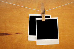 Old photos hang on clothespin Royalty Free Stock Photos