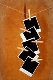 Old photos hang on clothespin on wood Royalty Free Stock Photo
