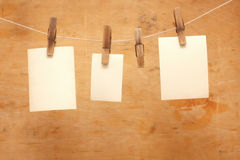 Old photos hang on clothespin on wood Royalty Free Stock Photography
