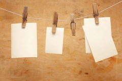 Old photos hang on clothespin on wood Royalty Free Stock Images