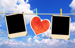 Old photos and paper heart. On blue sky Royalty Free Stock Photos