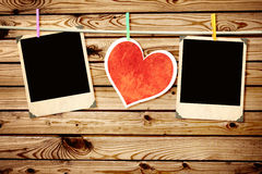 Old photos and paper heart. Two old photos and paper heart Royalty Free Stock Photography