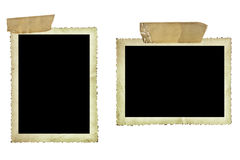 Old Photos with Sticky Tape over White. Vintage photo borders fastened with old sticky tape, isolated on white Stock Photography