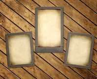 Old photos on wooden board Royalty Free Stock Photos