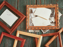 Old photos with a wooden framework on an authentic background Stock Photography