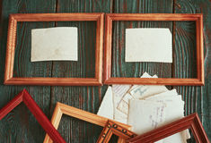 Old photos with a wooden framework on an authentic background Royalty Free Stock Photos