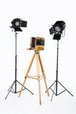 Old Photostudio. Old wooden photocamera and lighting royalty free stock photo