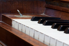 Old piano. Old vintage brown wood piano keys royalty free stock image
