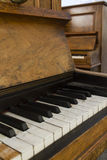 Old piano. Old fashioned worn wood piano Royalty Free Stock Image