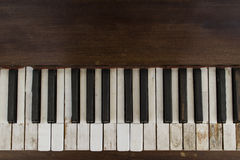 Old piano. Old fashioned worn wood piano Stock Photo