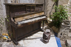 Old Piano. Abandoned in the yard Stock Images