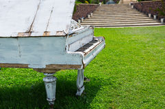 Old piano abandoned ouside. Photo of a Old piano abandoned ouside royalty free stock images