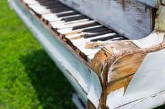 Old piano abandoned ouside. Photo of an old wreked piano stock image