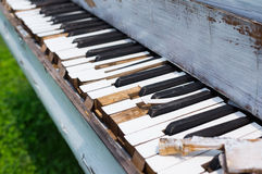 Old piano abandoned ouside. Photo of an old wreked piano stock images