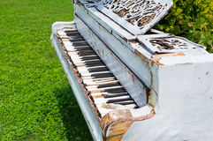 Old piano abandoned ouside. Photo of a Old wreked piano abandoned ouside royalty free stock image