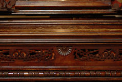 Old piano. Carved old ruff wooden piano Royalty Free Stock Photography
