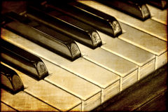 Old piano keys. A vintage piano original photograph with a close up on the keys with an old fashioned, sepia tone look stock images