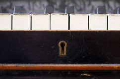 Old piano keys close up. With keyhole royalty free stock photos