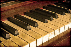 Old piano keys. Old piano close up on the keys with a vintage tone look. copyspace royalty free stock image