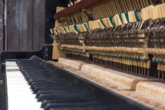 Old piano. Keys and small hammers with selective Royalty Free Stock Image