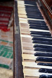 Old piano keys. Won back his old piano keys, which now stand on the street and is decorated with entrance to the cafe but the music was royalty free stock photo