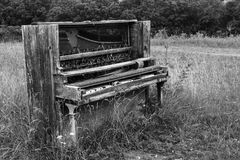 Old Piano in the Meadow Stock Image
