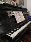 Old piano with notes, retro exposition