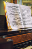Old piano with notes. Stock Images