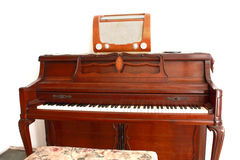 Old piano. With old transistor Royalty Free Stock Photo
