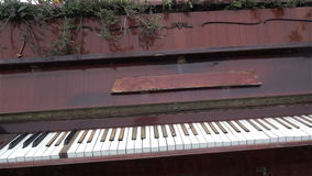 The old piano outside. Antique musical instruments. History. Museum, Art HD. The old piano outside. Antique musical instruments. History. Museum Art stock video footage