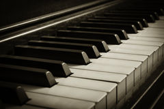 Old Piano. A unique perspective of piano keys on an old piano; sepia colortone Royalty Free Stock Images