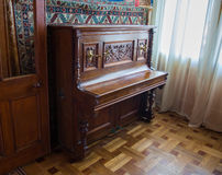 An old piano in Vorontsov Palace in Alupka. The palace is built in 1848 royalty free stock images
