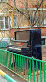 Old pianoforte abandoned outdoors Royalty Free Stock Images