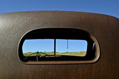 Old pickup cab (rear window view) Royalty Free Stock Photo