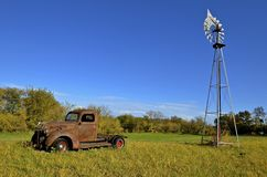 Old pickup and spraying boom Royalty Free Stock Photos