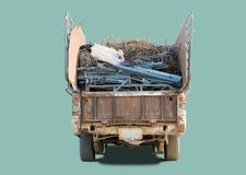 Old pickup truck. Carring scrap metal for recycling factory, isolated with clipping path royalty free stock images