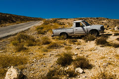 Old pickup truck on desert roadsid. Travel by car. Tourism and journey theme. Transportation, adventure concept. Summer holiday Royalty Free Stock Images