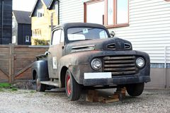 Old pickup truck. Old rusty and damaged black pickup truck Royalty Free Stock Image