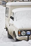 Old pickup van covered with snow. royalty free stock images