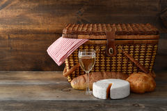 Old picnic basket with wine and cheese Stock Images