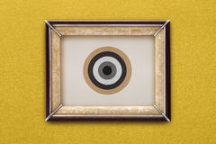 Old picture frame on a gold background Royalty Free Stock Image