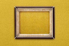 Old picture frame on a gold background Stock Images