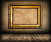 Old picture frame on interior background. With wooden floor Stock Photo