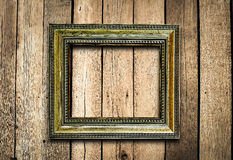 Old picture frame on vintage wood wall. Stock Image