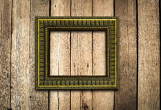 Old picture frame on vintage wood wall. Stock Photo