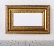 Old picture frame on a wall. Old frames over the white wall background stock images
