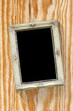 Old picture frame on Wood texture royalty free stock image
