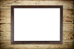 Old picture frame on wood wall. Old picture frame on wood background Royalty Free Stock Images