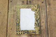 The old picture frame on wooden background Royalty Free Stock Photo